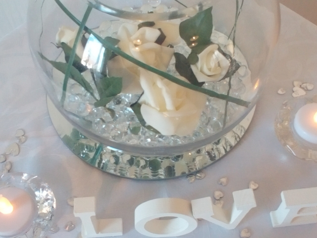 Goldfish bowl with crystals, roses and bear grass
