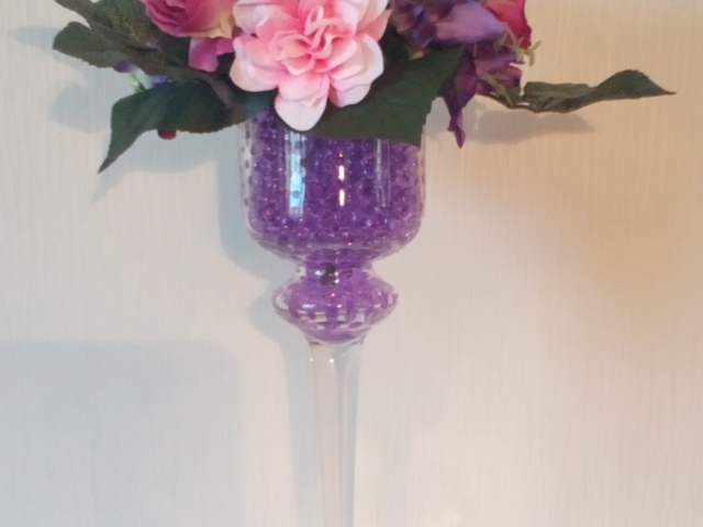 Tall candle holder for flowers or candles