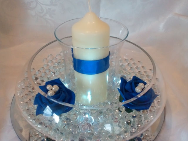 Floating candle dish with hurricane vase and candle