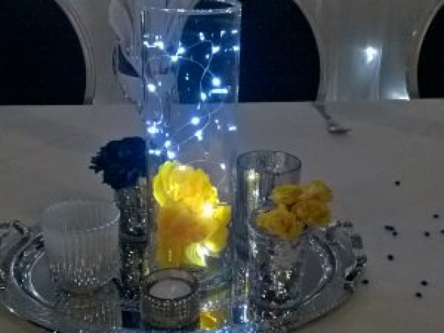 Cylindrical vase with lights, jars and candles for wedding