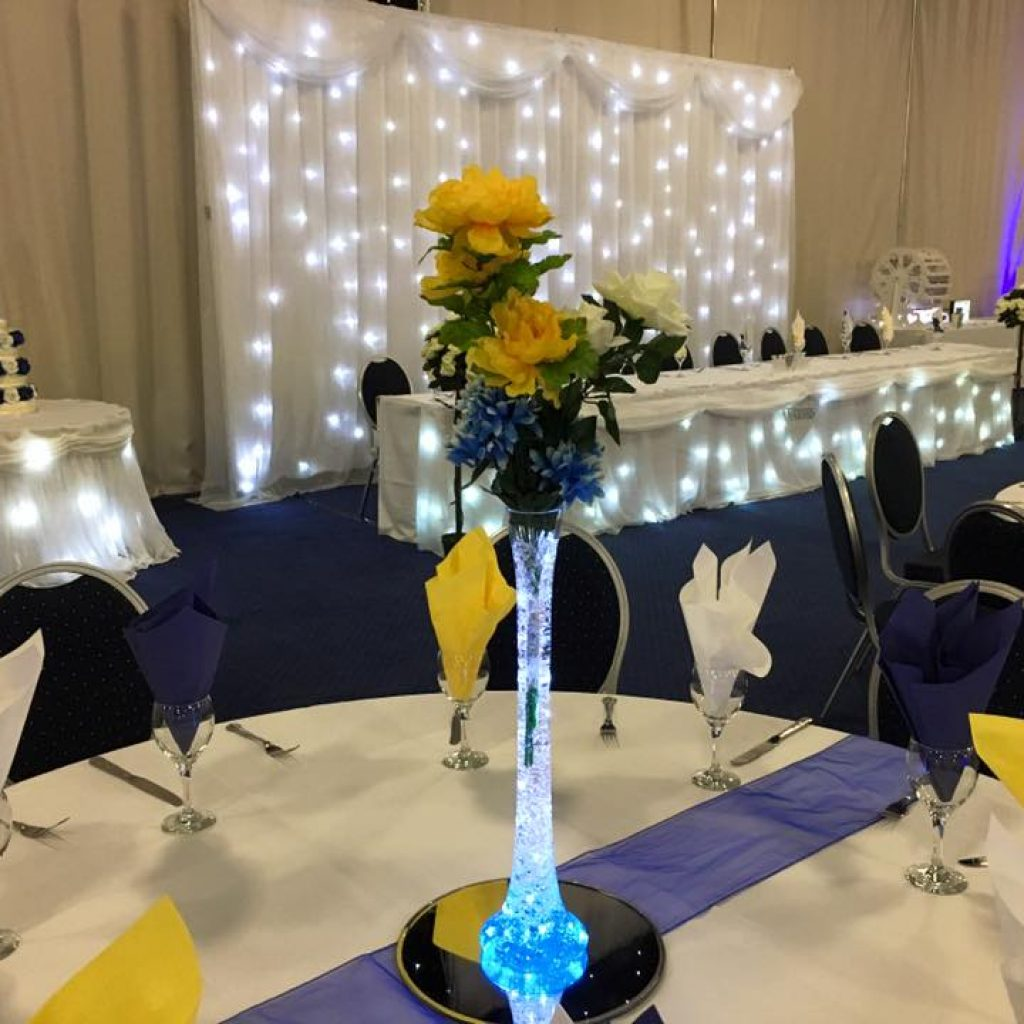 Lily vase wedding centrepiece with lights