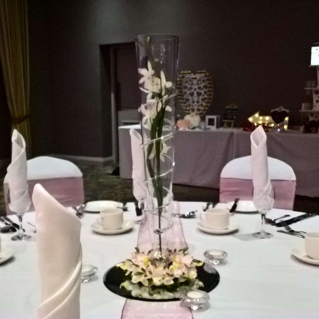 Wedding Centrepiece - Tall spiral vase with orchids