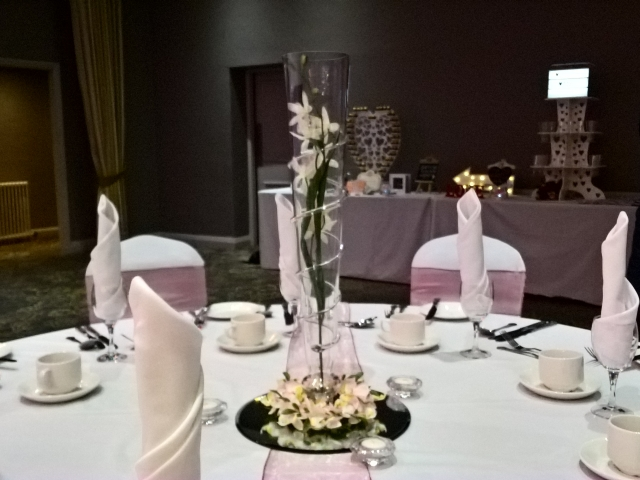 Tall vase with Twisted glass spiral details, orchid with orchid candle ring