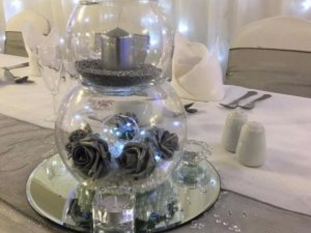 Double goldfish bowls, silver roses and candles