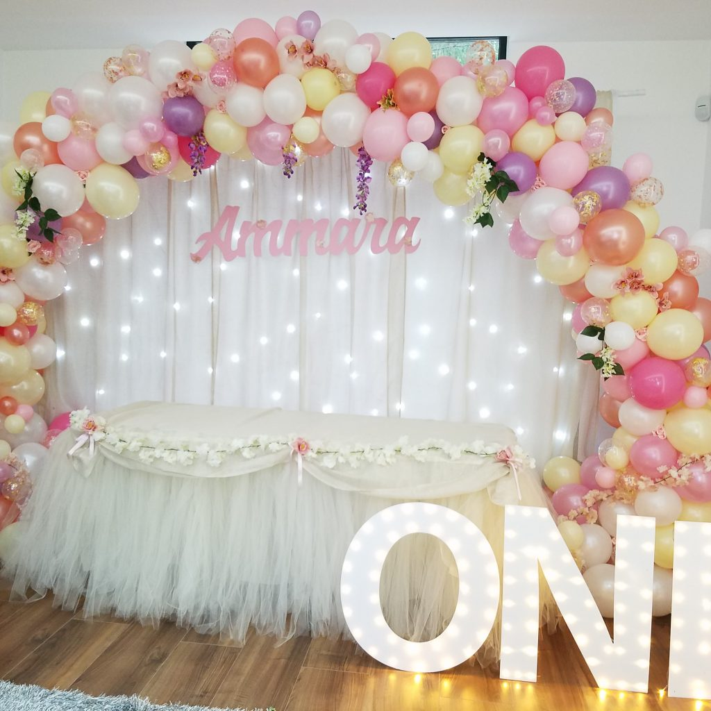 Organic balloon arch with floral accents