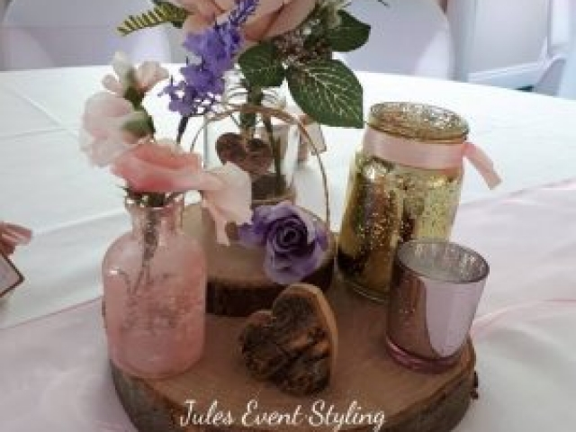 Rustic style centrepiece, log slice & jars